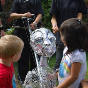 Two children look at the Star Child puppet