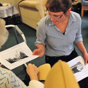 Artist shows work to older person