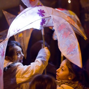 Children carry lanterns