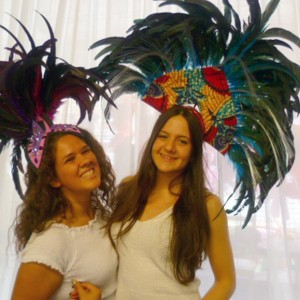 Volunteers model headdresses