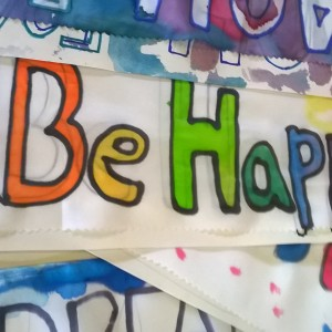 Silk with 'Be Happy' painted on it