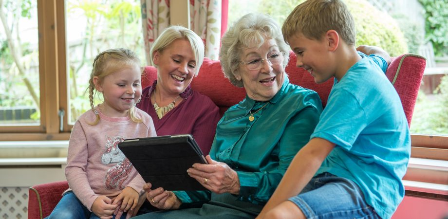 Family with older member use iPad together